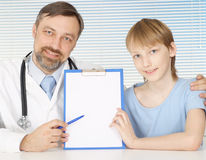 A nice adult Caucasian doctor with a boy sitting Royalty Free Stock Photography