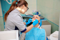 Nice adult guy on checking teeth in dental office Stock Images