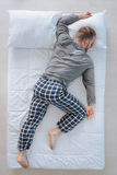 Nice adult man sleeping on his belly Royalty Free Stock Images