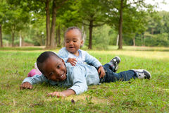 Nice african children. Happy little children are having a nice day in the park Royalty Free Stock Photo