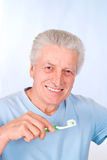 Nice aged guy brushes teeth Royalty Free Stock Photography