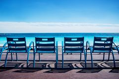 Nice, Alpes-Maritimes department,French Riviera,August 11, 2017,. Promenade des Anglais.Blue empty chairs on the Promenade des Anglais in Nice Stock Images