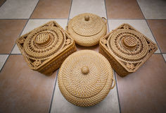 Nice amazing closeup view of old vintage woven storage baskets on ceramic tile floor Stock Image