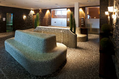Nice ambience in a wellnes spa sauna room. Mosaic tiled sitting group for wellness with several sauna and steaming rooms arround, with atmospheric and impressive Stock Images