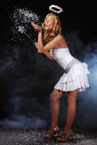 Nice angel girl blow snow Royalty Free Stock Photos