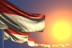 Nice any holiday flag 3d illustration - many Monaco flags on sunset placed diagonal with selective focused and place for text. Nice many Monaco flags on sunset vector illustration