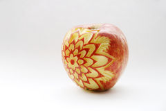 Nice apple. A special artwork - carving in apple Stock Photos