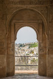 Nice arch door in ancient Arabian palace Alhambra. Granada, Spain Royalty Free Stock Photography