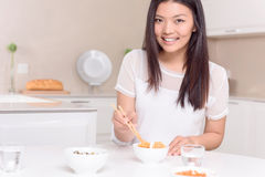 Nice Asian girl eating with sticks Royalty Free Stock Photos