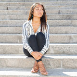 Nice asian girl sitting on stairs outdoor Stock Photography