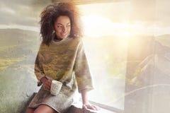 Nice attractive woman having tea Stock Images