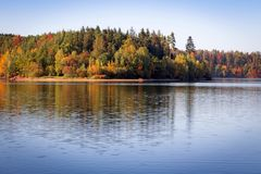 Nice autumn colorful trees with reflection on water, Czech lands royalty free stock photos