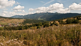 Nice autumn landscape with Male Borove village and Tatry mountains. Autumn landscape with meadows, Tatry mountains, forest and Male Borove village in Slovakia royalty free stock images