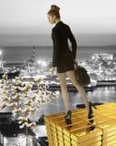 Nice bìusines woman on gold tower near sea port Stock Photography