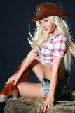 Nice babe in a cowboy's hat. On dark background royalty free stock photo