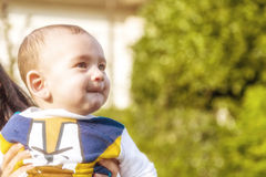 Nice baby biting lips puffing cheeks Stock Images