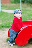 Nice baby boy age of 10 months on playground in summer Stock Photography