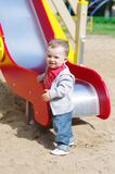 Nice baby boy on playground in summer. Nice baby boy age of 11 months on playground in summer Stock Photo