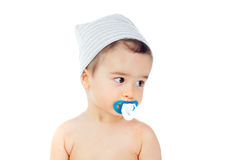Nice baby with grey cap and pacifier Stock Photos