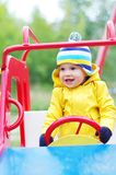 Nice baby on playground. Nice baby age of 1 months plays on playground Royalty Free Stock Image