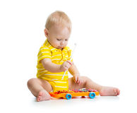 Nice baby playing musical toy Royalty Free Stock Photos