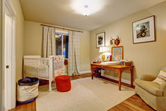 Nice baby room with hardwood floor. Nice baby room with hardwood floor and window Royalty Free Stock Photo