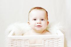 Nice baby in white basket Stock Images