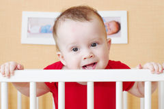 Nice baby in white bed. Nice baby age of 7 months in white bed stock image