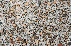 Nice background image of pebbles rock on a beach. Texture of mix colour pebbles stone Nice background image of pebbles on a beach royalty free stock photography