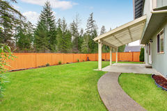 Nice backyard with covered patio. Royalty Free Stock Images