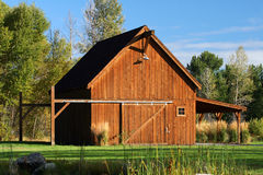 A Nice Barn. A barn next to a pond on an early summer\'s morning Stock Photography