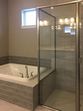 Nice bathtub and shower room in a new house Stock Photos