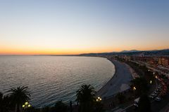 Nice beach day view, France. Nice beach day landscape, France. Nice beach and famous Walkway of the English, Promenade des Anglais. Famous French touristic town royalty free stock photography