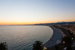 Nice beach day view, France. Nice beach day landscape, France.  Nice beach and famous Walkway of the English, Promenade des Anglais. Famous French touristic town royalty free stock photos