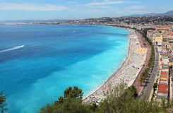 Nice beach , luxury resort of French riviera. Luxury resort of French riviera. Beautiful panorama city and public beach of Nice in France. Summer day. Famous Royalty Free Stock Image