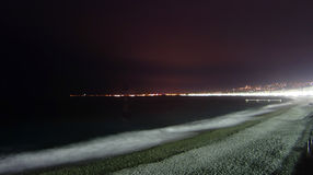 Nice beach at night. Scenic view of beach illuminated along Promenade des Anglais at night, Nice, France Stock Images