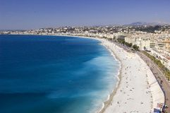 Nice Beach Panorama. Panoramic view of the beach and waterfront on the French Riviera in Nice Royalty Free Stock Image