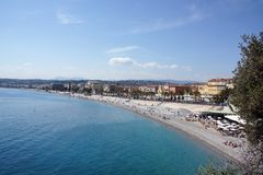 Nice Beach, South France. A photograph of the beach at Nice, South France, showing the tourist area, beach cafe and local apartments Royalty Free Stock Photo
