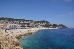 Nice Beach, South France. A photographof the beach at Nice, South France, showing the tourist area and local apartments Royalty Free Stock Photos