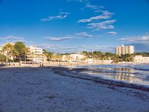 Nice beach view in mallorca island. Beach in peguera town in a calm weather day, nice sky and lovely sand for walk throw the area stock photos