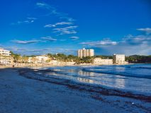 Nice beach view in mallorca island. Beach in peguera town in a calm weather day, nice sky and lovely sand for walk throw the area royalty free stock photography