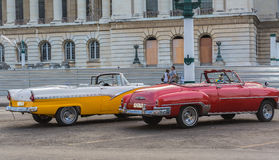 Nice  beautiful classic retro vintage taxi cars waiting for their clients near the capitol Cuban Havana city Royalty Free Stock Images