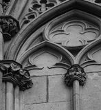 Nice and beautiful floral details by the window part 2. Shot in black and white, detail on the sculpture on the facade of this historic building representing Stock Photography