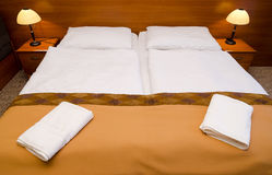 Nice bed in hotel Royalty Free Stock Photos