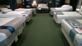 Nice  bed and mattress  selling at store Royalty Free Stock Images