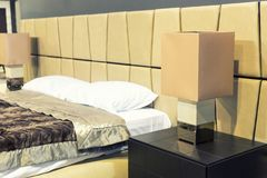 Nice bed in typical contemporary setting Stock Photo