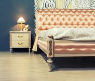 Nice bed in typical contemporary setting Royalty Free Stock Photography