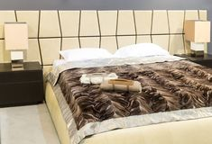 Nice bed in typical contemporary setting Stock Image