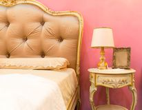 Nice bed in typical contemporary setting Stock Photography