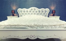 Nice bed in typical contemporary setting Royalty Free Stock Image
